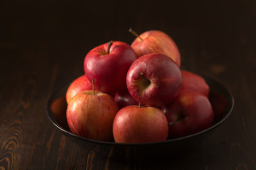 Red apples fruit on a dark background