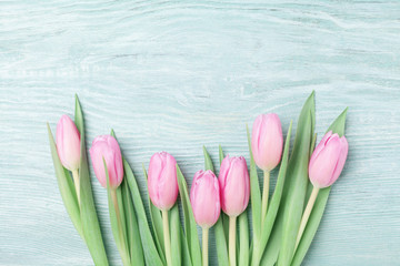 Heap of pink tulips for March 8, International Womans or Mothers day. Beautiful spring background. Top view.