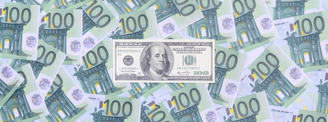 100 dollars bill is lies on a set of green monetary denominations of 100 euros. A lot of money forms an infinite heap