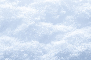 Snow surface texture background. Crystals and snowflakes. winter natural background.