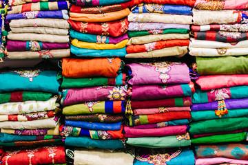 Colorful stacks of indian sari. Indian market.