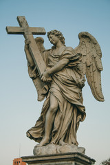 Angel with the Cross Sculpture on Ponte Sant'Angelo Rome Italy.