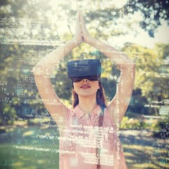 Woman standing with her hands joint while using a VR 3d headset