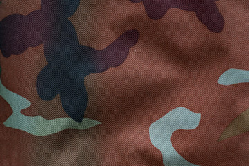 Fabric with military coloring for background. Khaki, camouflage