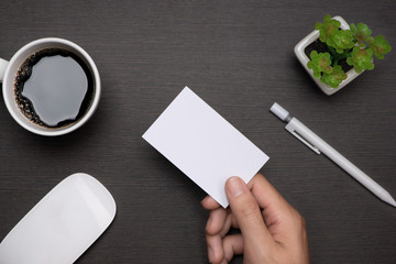 Mockup of white business cards in man's hand