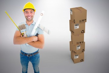 Composite image of portrait of happy manual worker holding