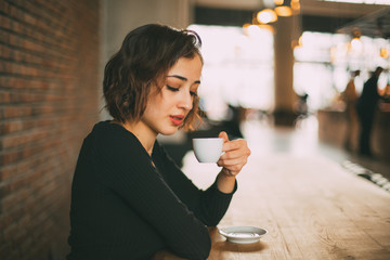 Beautiful Young Woman with Cup of Turkish Coffee