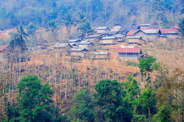 Side hill village alongside river rural of Laos, along the road