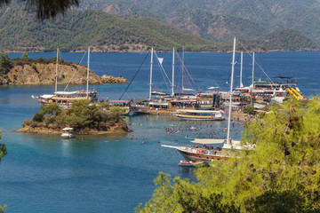 Excursion boats anchored in the bay of Yassica island, near Fethiye, in the Aegean sea, Turkey.