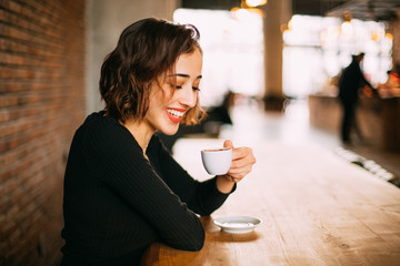 Smiling Young Woman with Cup of Turkish Coffee
