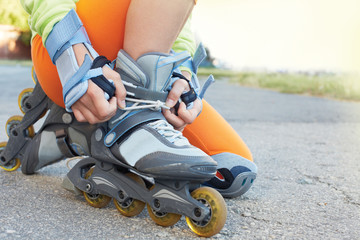 Setting of laces on black roller skates. Active sports.