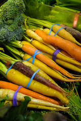Fresh and colorful variety of carrots in bunches in farmers market