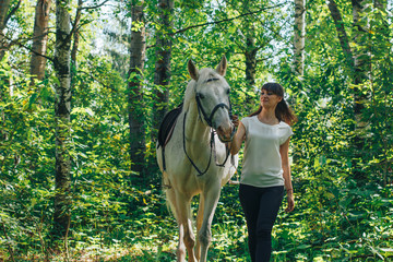 Girl and horse in the woods
