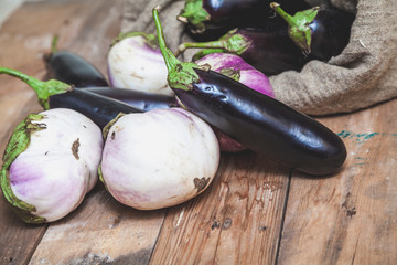 bag of blue eggplants rests on white