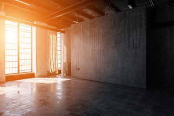 Bright light streaming into empty warehouse room