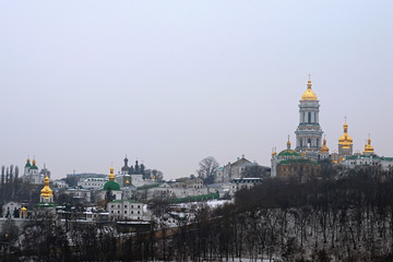 Winter view of Kyievo-Pechers'ka lavra and Belltower on blue sky background. It is a historic Orthodox Christian monastery. Morning landscape photo. Kyiv, Ukraine