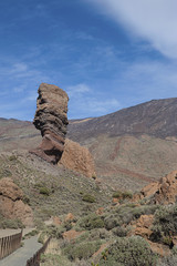 Vertical shot of Roque Cinchado and surroundings under midday sunlight, popular attraction in the Teide National Park, Tenerife, Canary Islands