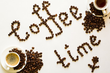 Two cups of espresso and Coffee time text from beans on white table. Top view
