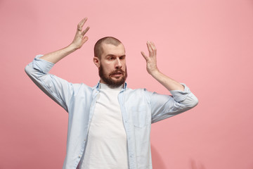 Beautiful man in stress isolated on pink