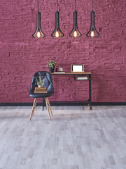 black leather fabric chair and interior design work desk, colored stone wall modern lamp