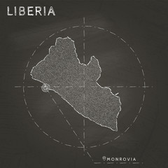 Liberia chalk map with capital marked hand drawn on textured school blackboard. Chalk Liberia outline with Monrovia marked. Vector illustration.