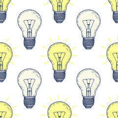 Seamless pattern with hand drawn light bulbs. Background with doodle lamps