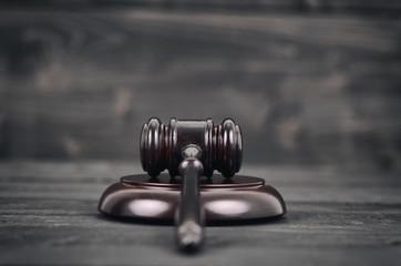 Judge Gavel on a black wooden background.