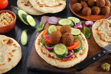 Falafel balls on pan fried pita bread