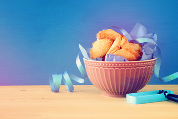 Purim celebration concept (jewish carnival holiday). Traditional hamantaschen cookies.