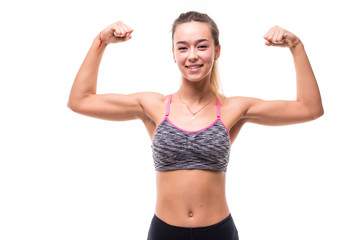 Fitness woman excited isolated on white background. Caucasian female model smiling and showing muscles