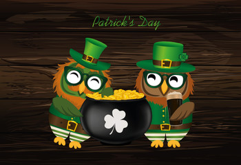 Two happy owls with a pot of gold coins in a national costume
