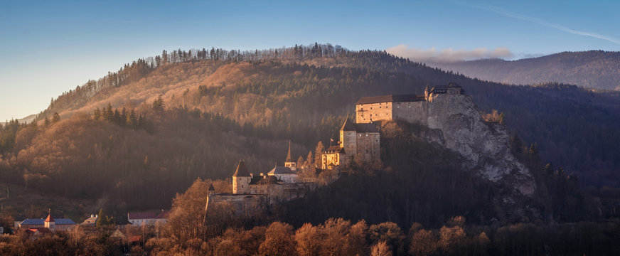 Beautiful sunset over Orava Castle - is situated on a high rock above Orava river in the village of Oravský Podzámok, Slovakia.