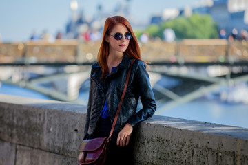 Young girl in sunglasses at Parisian streets