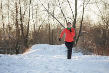 Picture of brunette athlete running in winter park