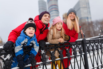 Picture of parents with children on winter walk