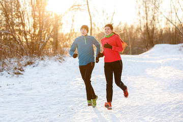 Photo of two athletes on morning run in winter park
