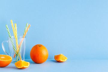 Orange juice on a blue pastel background