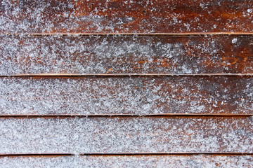 snow on brown wooden background