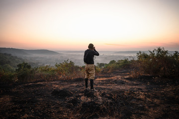 Travel photographer taking a shots at sunrise