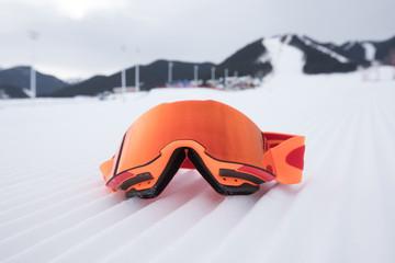 snowboard goggles on ski piste slop