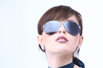 Beautiful woman in sunglasses looking up isolated on white backg