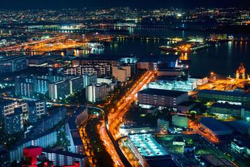 Aerial view of the Osaka Bay harbor area at night