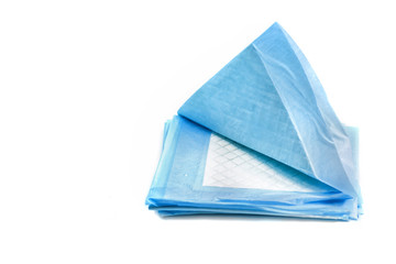 pile of absorbing pads for pets isolated on white. home training carpets for animals