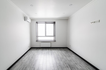 high definition empty white room with window and floor of new house. For rent. Sale house.