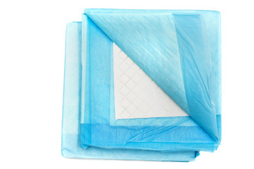 toilet training pads for pets isolated on white. home absorbing carpets for animals