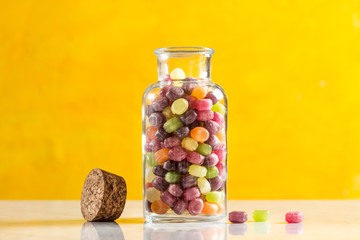 Candy Jar on Yellow Background