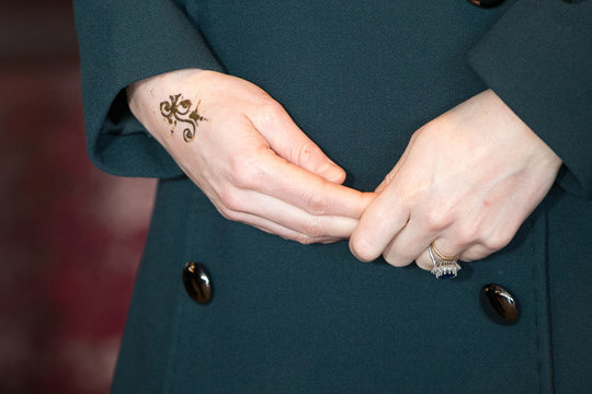 Britain's Catherine Duchess of Cambridge displays a henna tattoo she was given during her visit to The Fire Station, a newly converted music and arts club, in Sunderland
