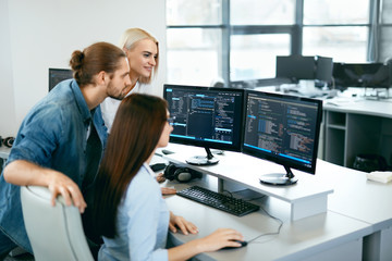 IT Team Working In Office. People Programming On Computer