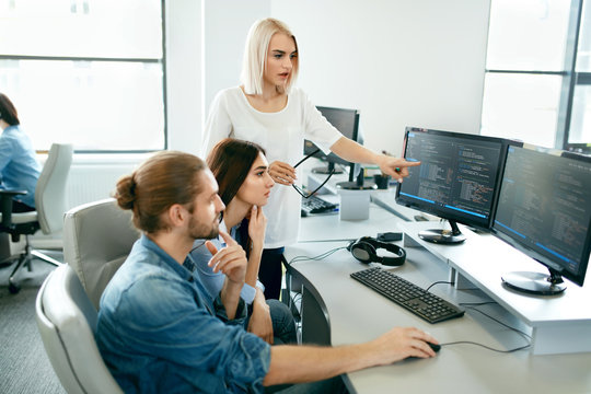 IT office. People Working At Open Workplace