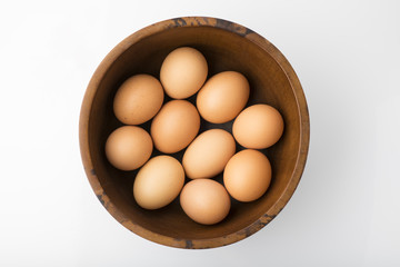 Food: Top View of Brown Eggs in Wooden Bowl Isolated on White Background Shot in Studio